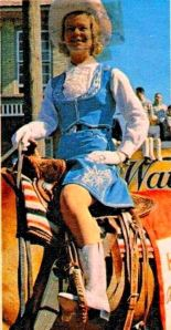 Duchess of Kent riding in the Calgary Stampede Parade - outfit by Elfriede