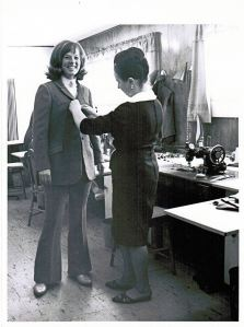 Elfriede making final adjustments to Diane's suit (one of two created for each of the ladies)